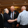 Peter Buxton, 3nd fro left, is greeted by family and friends before the start of the dinner to honor him for the William E. May Award. Nashoba Valley Voice Photo by David H. Brow.