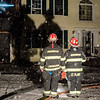 Captain John Bresnahan and Lieutenant Bob Plant survey the damage after a three-alarm fire at 17 Birchwood Terrace in Ashburnham on Tuesday evening. SENTINEL & ENTERPRISE / Ashley Green