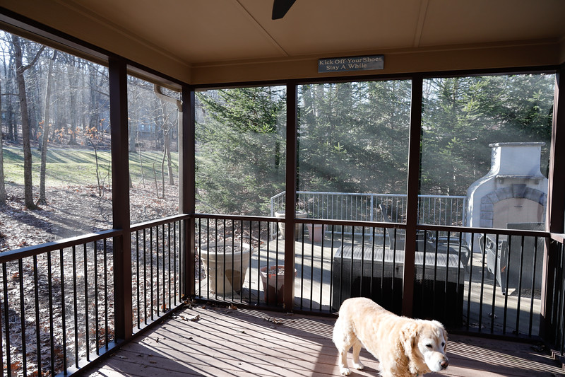 View of Side Deck steps at left & outdoor gas prefab fireplace.