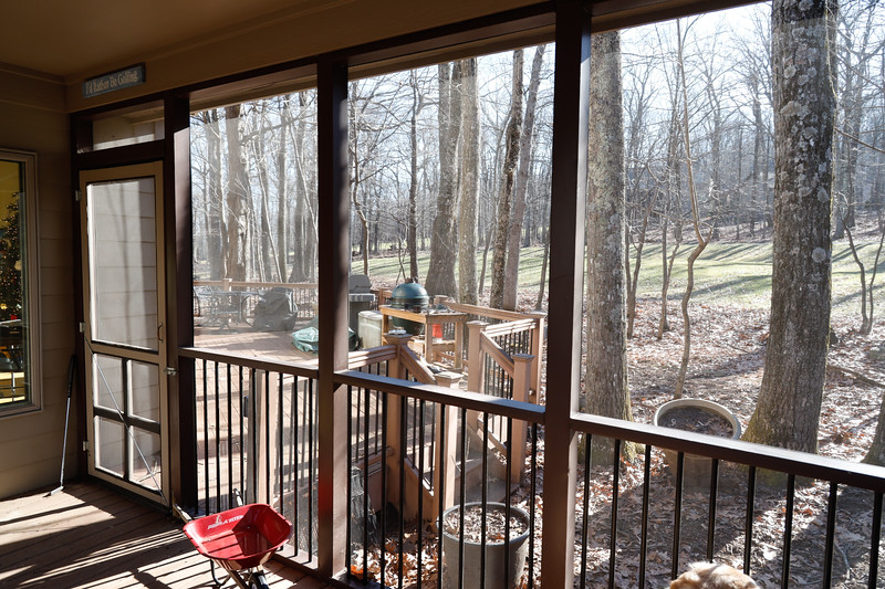 View from Porch of Front deck, green egg and grill.