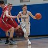Lunenburg's Adam Peplowski gets around a Hudson defender during a game at Lunenburg High School on Tuesday, Feb. 21, 2017. Hudson won the game, 53-50.  SENTINEL&ENTERPRISE/ Jim Marabello