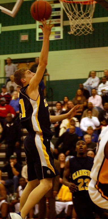 . Clarkston High School boys basketball player Brandon Pokley puts in a layup against Flint Southwestern during second quarter action, Wednesday, March 5, 2008, in a regional game played at Lake Orion HS in Lake Orion, Mich.  (The Oakland Press/Jose Juarez)