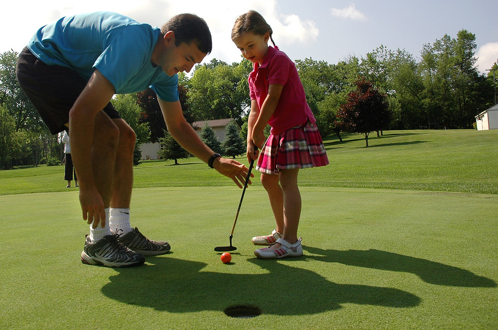 . Owner of Tiny Tots Joel Wells instructs 5-year-old McKenzie Wright of Independence Township.