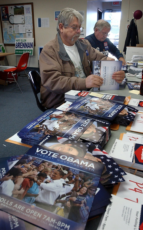 . (from left) Dan Leveille and Joe Stetz, both of Waterford, bundle Obama campaign literature to be passed out Saturday at the Michigan Democratic Campaign Headquarters in Waterford Twp.
