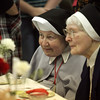 Sister Helen Theresa Fleischman and Sister Rosemary Laux take in the joyful atmosphere.