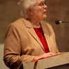 C.PP.S. Sister Mary Garke proclaims the Scripture readings and general intercessions.