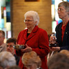 Sisters Edna Hess and Barbara Brown present the gifts of bread and wine.