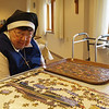 Visitors to the Open House met the sisters working on hobbies and crafts. Here Sister Wilfred Thobe works on a puzzle.
