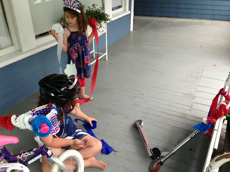 Hard at work decorating their bike and scooter.