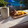 A new tradition - breakfast on the balcony with coffee from the little restaurant by the pool, a pastry  (oatmeal scone drizzled with chocolate) and  fresh fruit.