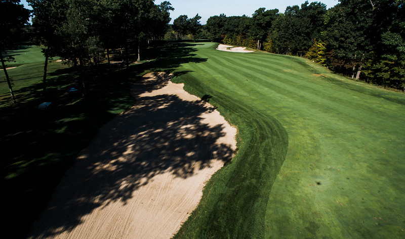 "Red Tail Golf Club<br /> ""Hole 10 is a 560-yard, slight dogleg left par 5 with a bit of a<br /> forced carry off the tee and out of bounds down the right side of the<br /> fairway. The OB stretches from the tee for roughly 280 yards. After<br /> 280, the right side becomes an environmentally sensitive hazard, which<br /> restricts player entry and requires a ball drop. The left side is tree<br /> lined with an 80-yard long bunker catching many second shots."" --<br /> Chris Kasheta, Red Tail Golf Club<br /> SENTINEL & ENTERPRISE / Ashley Green"