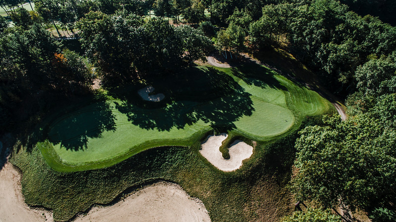 "Red Tail Golf Club<br /> ""Hole 11 is a 180-yard par 3 over an abandoned military gravel pit.<br /> Even from the forward tee, your tee shot must carry a portion of this<br /> ravine. A missed shot can end up 30 feet below the putting surface on<br /> hard packed sand. Not an easy shot. Visually it's an outstanding<br /> look."" -- Chris Kasheta, Red Tail Golf Club<br /> SENTINEL & ENTERPRISE / Ashley Green"
