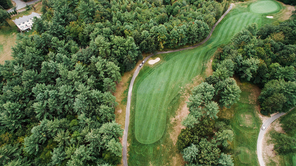 . Townsend Ridge Country Club Hole #11 - 400 YDS (Blue Tees) - 375 YDS (White Tees) - 365 YDS (Silver Tees) - 295 YDS (Red Tees) - Handicap #2 �The hardest hole on the backside at Townsend Ridge is a dogleg right par 4. The hole is not the longest, but it cannot be overpowered. Players are forced to hit another 215 yard tee shot off the tee with hazard running up the left hand side of the hole and tree troubles to the right. A properly placed tee shot will leave a lengthy approach of 150-180 yards into the hole. The green complex slopes pretty severely from right to left. Any approach shots that are left will kick into the hazard that lurks close to the green and any shot that misses the green to the right leaves an impossible chip off a downhill lie to a green that runs away. The approach shot always plays a little longer than the yardage. This hole requires a good tee shot, a good approach shot and some great short game work to make par. While the drive isn�t as difficult as  No. 4 and the approach isn�t as difficult as No. 8, this is widely regarded as one of the most difficult holes on the course because it requires your attention throughout.� -- Derick Fors, General Manager & Head Golf Professional, Townsend Ridge Country Club SENTINEL & ENTERPRISE / Ashley Green