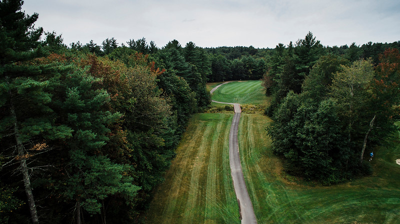"Townsend Ridge Country Club<br /> Hole #11 - 400 YDS (Blue Tees) - 375 YDS (White Tees) - 365 YDS<br /> (Silver Tees) - 295 YDS (Red Tees) - Handicap #2<br /> ""The hardest hole on the backside at Townsend Ridge is a dogleg right<br /> par 4. The hole is not the longest, but it cannot be overpowered.<br /> Players are forced to hit another 215 yard tee shot off the tee with<br /> hazard running up the left hand side of the hole and tree troubles to<br /> the right. A properly placed tee shot will leave a lengthy approach of<br /> 150-180 yards into the hole. The green complex slopes pretty severely<br /> from right to left. Any approach shots that are left will kick into<br /> the hazard that lurks close to the green and any shot that misses the<br /> green to the right leaves an impossible chip off a downhill lie to a<br /> green that runs away. The approach shot always plays a little longer<br /> than the yardage. This hole requires a good tee shot, a good approach<br /> shot and some great short game work to make par. While the drive isn't<br /> as difficult as  No. 4 and the approach isn't as difficult as No. 8,<br /> this is widely regarded as one of the most difficult holes on the<br /> course because it requires your attention throughout."" -- Derick Fors,<br /> General Manager & Head Golf Professional, Townsend Ridge Country Club<br /> SENTINEL & ENTERPRISE / Ashley Green"