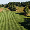 """Westminster Country Club<br /> Hole 14<br /> """"The 14th hole is a 537-yard dogleg left with OB left the whole way.<br /> The average player will hit a second shot to the flat 150-yard mark.<br /> From here, you will have a blind shot into a two-tiered green with a<br /> lot of different breaks depending on your angle."""" -- -- Michael<br /> Leblanc, Director of Golf Operations Westminster Country Club<br /> SENTINEL & ENTERPRISE / Ashley Green"""