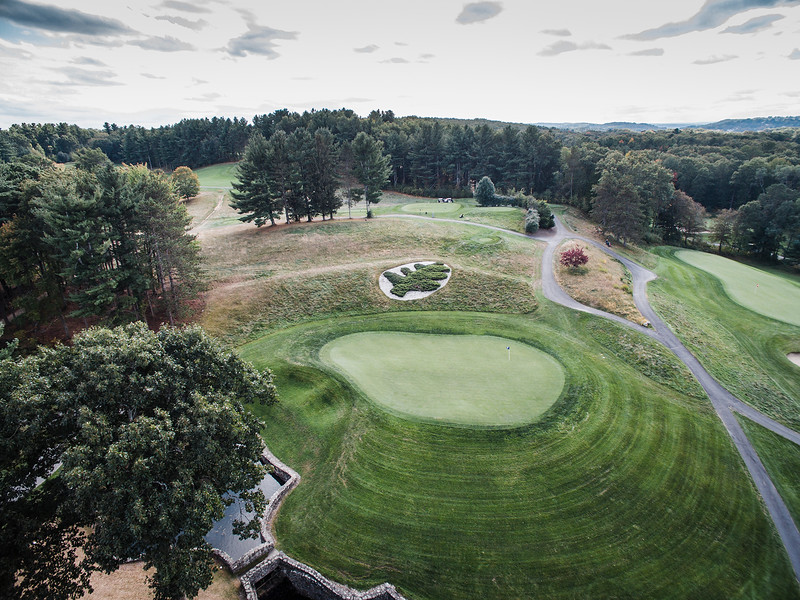 "The International <br /> Hole No. 16 Pines Course<br /> ""With several choices of teeing ground to play from, this picturesque<br /> and signature hole provides a majestic view of a fantastic par 3.<br /> Measuring 277 from the Tiger Tees, or 174 from the closet tees, this<br /> hole provides a mental and physical challenge. One must carry it all<br /> the way to the green or it will come straight down the hill. The old<br /> rock creek that runs perpendicular across the fairway creates a<br /> beautiful view, as well a a treacherous pitch back to the green. The<br /> undulated green adds to the potentially inflated score. Embrace the<br /> beauty and demand."" -- -- Brendan Reilly, Director of Golf at The<br /> International<br /> SENTINEL & ENTERPRISE / Ashley Green"