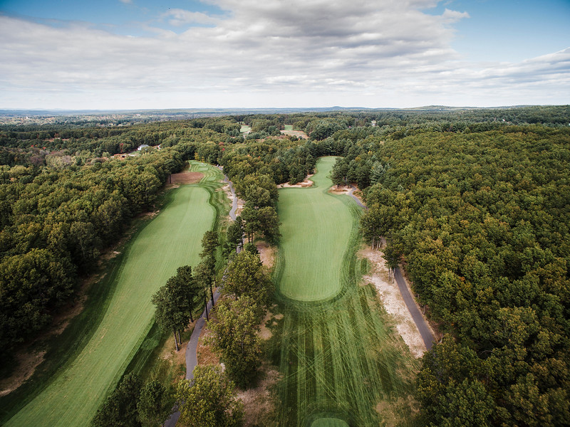 """The International <br /> Hole 15 Oaks Course<br /> """"This straightaway par 4 appears fairly straightforward until you get<br /> about 160-180 yards away. You must stay left center on your drive in<br /> order to have a clear view shot to a narrow and deep green. The second<br /> shot may require some skill as the right part of the fairway has a few<br /> trees blocking the green. There is a speed slot that will favor the<br /> ball to move to the left which is ideal on your drive. Once near the<br /> green, the depth creates a hole new set of challenges including an<br /> undulated green. There are no bunkers around the green to allow for a<br /> bump and run, but don't go long."""" -- -- Brendan Reilly, Director of<br /> Golf at The International<br /> SENTINEL & ENTERPRISE / Ashley Green"""