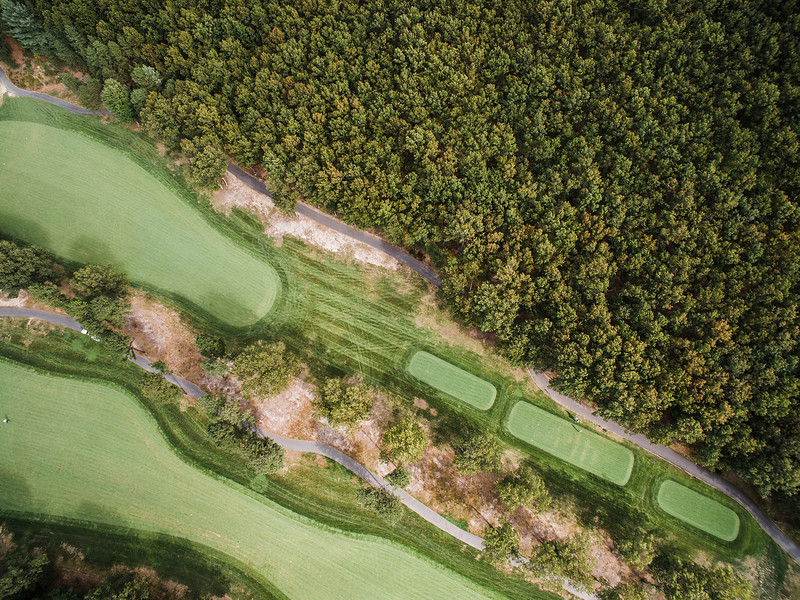 "The International <br /> Hole 15 Oaks Course<br /> ""This straightaway par 4 appears fairly straightforward until you get<br /> about 160-180 yards away. You must stay left center on your drive in<br /> order to have a clear view shot to a narrow and deep green. The second<br /> shot may require some skill as the right part of the fairway has a few<br /> trees blocking the green. There is a speed slot that will favor the<br /> ball to move to the left which is ideal on your drive. Once near the<br /> green, the depth creates a hole new set of challenges including an<br /> undulated green. There are no bunkers around the green to allow for a<br /> bump and run, but don't go long."" -- -- Brendan Reilly, Director of<br /> Golf at The International<br /> SENTINEL & ENTERPRISE / Ashley Green"