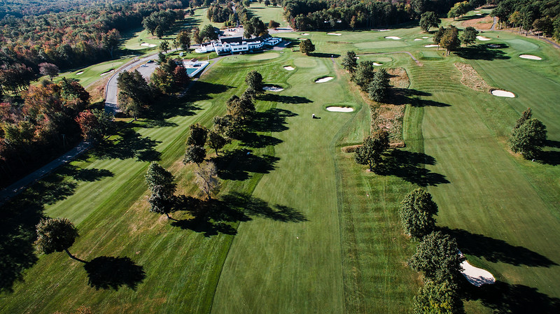 "Oak Hill Country Club<br /> Hole 4<br />  ""A good drive on this hole will leave you a second shot of 170-210<br /> yards to the green. If you cannot reach this green in two shots then<br /> you must also avoid the two fairway bunkers that are about 40 yards<br /> from the green. The fairway extends beyond the trap on the right all<br /> the way through to the top of the green and can be used as a bail out<br /> area that will still allow you to get up and down. The green is two<br /> tiered and slopes from back to front.  It is the narrowest green on<br /> the front side.  A 4 is a great score on this hole."" -- Bucky<br /> Buchanan, Head Golf Pro at Oak Hill Country Club<br /> SENTINEL & ENTERPRISE / Ashley Green"