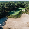 """Red Tail Golf Club<br /> """"Hole 11 is a 180-yard par 3 over an abandoned military gravel pit.<br /> Even from the forward tee, your tee shot must carry a portion of this<br /> ravine. A missed shot can end up 30 feet below the putting surface on<br /> hard packed sand. Not an easy shot. Visually it's an outstanding<br /> look."""" -- Chris Kasheta, Red Tail Golf Club<br /> SENTINEL & ENTERPRISE / Ashley Green"""