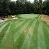 """Townsend Ridge Country Club<br /> Hole #4 - 432 YDS (Blue Tees) - 390 YDS (White Tees) - 366 YDS (Silver<br /> Tees) - 325 YDS (Red Tees) - Handicap #1<br /> """"Widely regarded as one of the most difficult holes around. The fourth<br /> hole at TRCC is a beast. The lengthy par 4 can stretch out to 432<br /> yards and plays much longer as it is uphill the entire way. The<br /> landing area is where the steepest slope on the hole lies, which takes<br /> most, if not all the roll off properly-placed tee shots. The most<br /> difficult part of the hole is certainly the tee shot, as players are<br /> welcomed by one of the most intimidating visuals in golf. Tree-lined<br /> hazards encompass both sides of the hole and at its widest, the<br /> fairway measures a mere 17 yards wide. If you are up to the challenge,<br /> and find the fairway, the difficulties do not stop there. The uphill<br /> approach shot is somewhat blind and is most often played from an<br /> uneven lie. The green complex is large, but is guarded by three sand<br /> traps on the left and hazards to the right hand side and directly<br /> behind the green. The green slopes back left to front right and has<br /> some subtle mounding that can make certain pin placements extremely<br /> tricky. If you make par here, you should be proud of yourself."""" --<br /> Derick Fors, General Manager & Head Golf Professional, Townsend Ridge<br /> Country Club<br /> SENTINEL & ENTERPRISE / Ashley Green"""