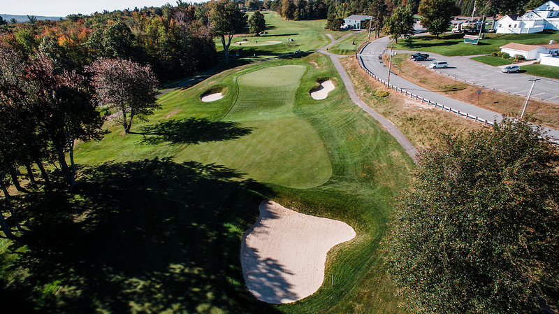 """Oak Hill Country Club<br /> No. 18<br /> Description: 446 Yard Par 4<br /> """"No shortcuts here. This hole is one of the toughest finishing holes<br /> that you will ever play anywhere. This uphill par 4 plays longer than<br /> the yardage would indicate and with a good tee shot you will still<br /> have 180-220 yards left to an elevated green. If you do not carry the<br /> ball to the green, the ball will roll back down into a swale in front<br /> of the green leaving you with a very difficult up-and-down for par.<br /> Once on the green, be careful not to putt it off the green if the pin<br /> is toward the front portion of the green, very slick downhill putts.<br /> You will win many a match here with a par 4."""" -- Bucky Buchanan, Head<br /> Golf Pro at Oak Hill Country Club<br /> SENTINEL & ENTERPRISE / Ashley Green"""