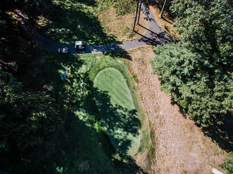 """The International<br /> Hole No. 5 Pines Course<br /> """"This par 5 measuring over 700 yards from the """"Tiger Tees"""" is an<br /> impressively massive hole in more ways than its measurements. Most<br /> people play from the white tees, and certainly no slouch at nearly 600<br /> yards. A demanding drive is required, but your second shot is crucial<br /> in your endeavor to make par. At about 125 yards from the green, the<br /> hole sharply doglegs left so the second shot ideally requires a little<br /> bit of a draw. If executed well, you will have inside 150 yards to<br /> this half-acre of green. Front to back of this green is almost a<br /> five-club difference. A back or even middle pin placement, could<br /> create well over an 80-foot putt at times. Quite honestly, a<br /> spectacular hole that will give you a sense of accomplishment upon<br /> successful completion."""" -- Brendan Reilly, Director of Golf at The<br /> International<br /> SENTINEL & ENTERPRISE / Ashley Green"""