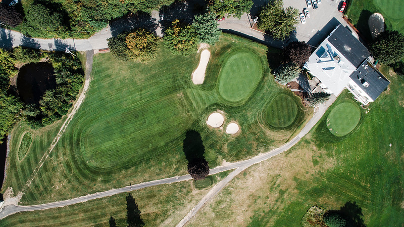 Moonoosnock Country Club<br /> Hole 5<br /> The toughest par 3 in our area is No. 5 at Monoosnock Country Club.<br /> This uphill par 3 measures 235 yards from the back of the tee.  Rarely<br /> played from all the way back the hole measures 214 yards from the<br /> blue/white tees and 195 yards from the red/green tees on the<br /> scorecard. The uphill distance of this hole is not at the top of the<br /> list for the reasons this hole is so tough. Up near the top of the<br /> list is the slope and narrowness of the green, followed by three front<br /> bunkers which easily come into play because of their location. The<br /> slight opening between the bunkers makes it extremely difficult to<br /> roll the ball onto the green. The hole, despite its distance, requires<br /> a high shot which is extremely difficult to do given the yardage<br /> length and uphillness of this hole. Other factors of difficulty is the<br /> prevailing wind, which is mostly against the players and the out of<br /> bounds to the left and over the green. A truly difficult and<br /> challenging par 3 golf hole. And in my opinion, the toughest par 3 in<br /> our area. -- Bernie DiPasquale, Monoosnock CC<br /> SENTINEL & ENTERPRISE / Ashley Green