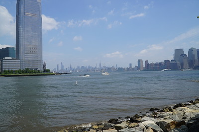 In the distance, looking north up the Hudson River, is the Empire State Building.