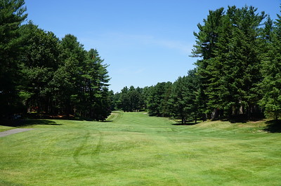 Needham Golf Club:  #4 tee, par 4, 378 yards.  Always loved this hole, driving from a plateau into a valley, surrounded by tall pines.