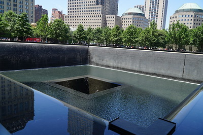 The 9-1-1 Memorial.  Two large fountain pools occupy the former footprints of the WTC towers.