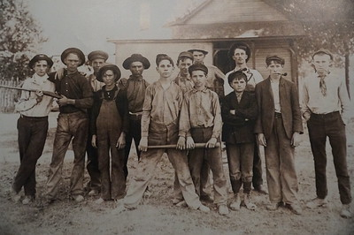 """The Ball Team"" (c 1910).  Bat.  Check.  Pipes.  Check.  Rifle.  Check.  Play ball!"