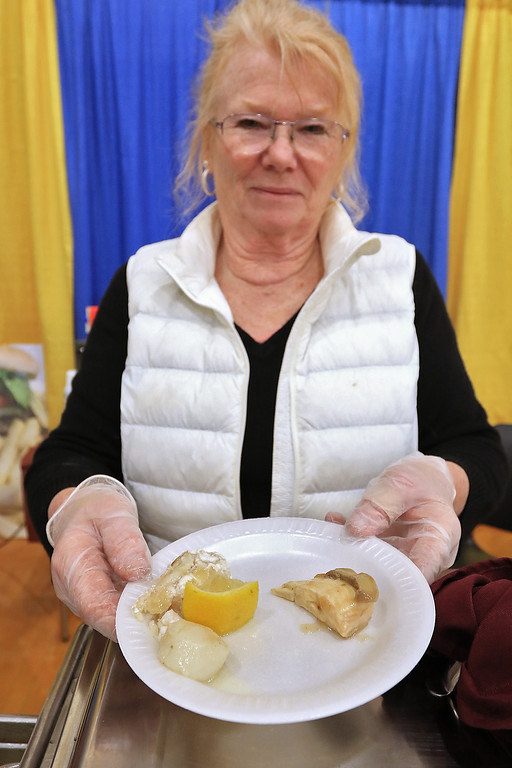 . The 18th Annual Taste of Nashoba, sponsored by the Nashoba Valley Chamber of Commerce, was held on Tuesday night at Lawrence Academy\'s Stone Athletic Center. Owner of Charlotte\'s Cozy Kitchen and Catering in Pepperell Charlotte Chabot was serving up some haddock and scallop with chicken marsala. SENTINEL & ENTERPRISE/JOHN LOVE