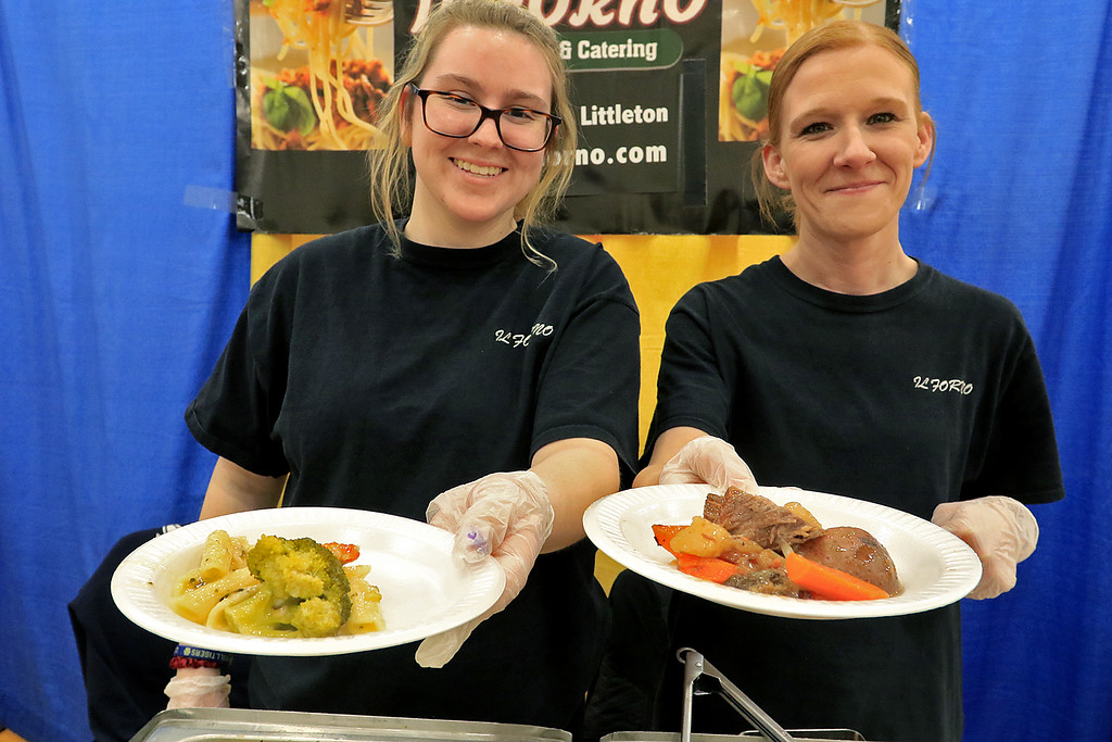 . The 18th Annual Taste of Nashoba, sponsored by the Nashoba Valley Chamber of Commerce, was held on Tuesday night at Lawrence Academy\'s Stone Athletic Center. Il Forno employees Katie Nekrasz and Julie Davis show their two dishes that they where serving up at the event. Nekrasz is holding their chicken broccoli and Davis is holding their beef burgandy. They have two restaurants one in Littleton and one in Fitchburg. SENTINEL & ENTERPRISE/JOHN LOVE