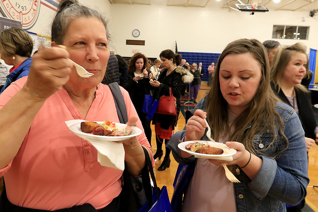 . The 18th Annual Taste of Nashoba, sponsored by the Nashoba Valley Chamber of Commerce, was held on Tuesday night at Lawrence Academy\'s Stone Athletic Center. Leominster\'s Comeketo Brazilian Steakhouse\'s dish was a top sirloin steak cooked over a a charcoal grill with sea salt and served over rice with pork sausage mild and drizzled with chimichurri sauce . Trying this dish is Kathy Sacarmeas from Chelmsford and Colleen Gavin from Billerica. SENTINEL & ENTERPRISE/JOHN LOVE