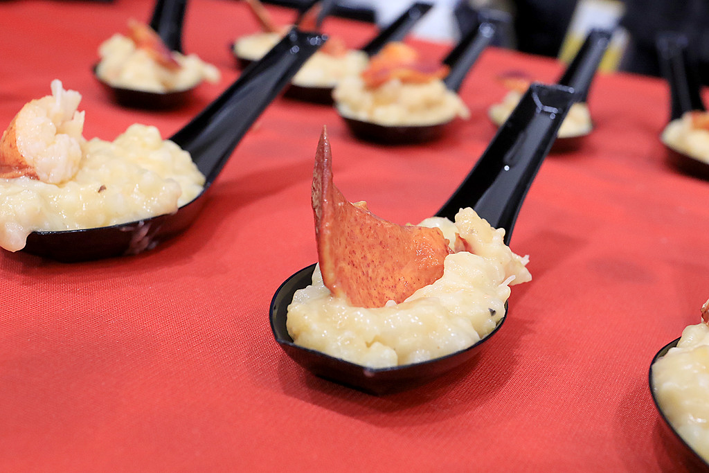 . The 18th Annual Taste of Nashoba, sponsored by the Nashoba Valley Chamber of Commerce, was held on Tuesday night at Lawrence Academy\'s Stone Athletic Center. Al Mariano owner of Mariano\'s Ristorante in Pepperell was serving up lobster risotto at the event on small spoons. SENTINEL & ENTERPRISE/JOHN LOVE