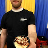 The 18th Annual Taste of Nashoba, sponsored by the Nashoba Valley Chamber of Commerce, was held on Tuesday night at Lawrence Academy's Stone Athletic Center. Mike Ravalese the cook for Evviva Trattoria of Westford shows off their dish of wild boar and Cacciatore. SENTINEL & ENTERPRISE/JOHN LOVE