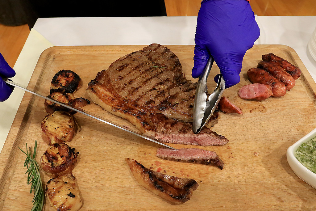 . The 18th Annual Taste of Nashoba, sponsored by the Nashoba Valley Chamber of Commerce, was held on Tuesday night at Lawrence Academy\'s Stone Athletic Center. Leominster\'s Comeketo Brazilian Steakhouse\'s owner Rodrigo Souza cuts up some top sirloin steak that he was serving at the event. SENTINEL & ENTERPRISE/JOHN LOVE
