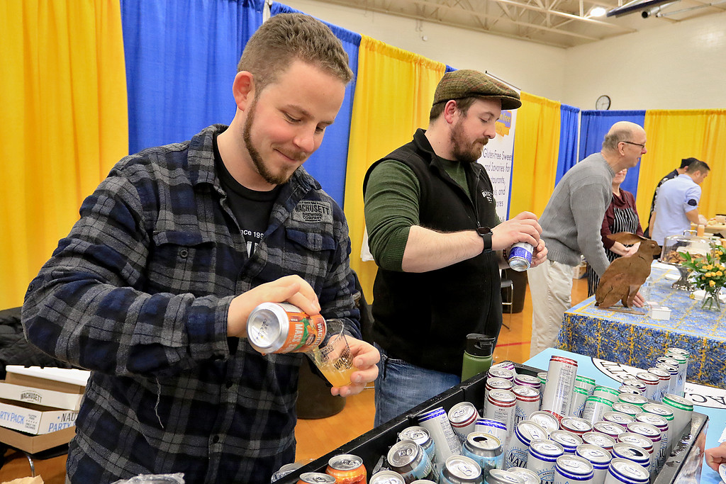 . The 18th Annual Taste of Nashoba, sponsored by the Nashoba Valley Chamber of Commerce, was held on Tuesday night at Lawrence Academy\'s Stone Athletic Center. Alex Gray of Ashby serves up some of the drinks from Wachusett Brewery at the event. SENTINEL & ENTERPRISE/JOHN LOVE