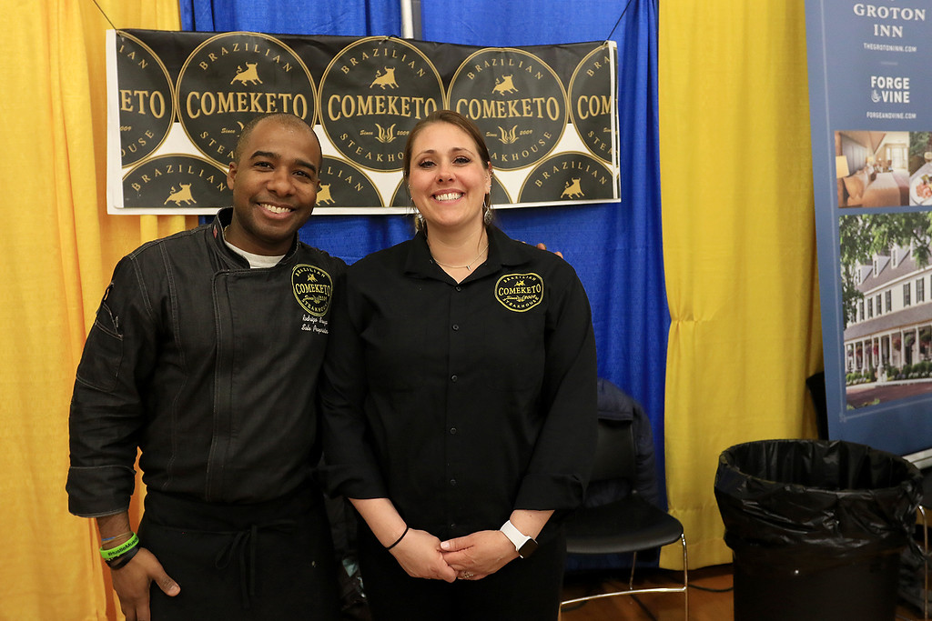. The 18th Annual Taste of Nashoba, sponsored by the Nashoba Valley Chamber of Commerce, was held on Tuesday night at Lawrence Academy\'s Stone Athletic Center. Rodrigo Souza owner of Comeketo Brazilian Steakhouse in Leominster with his employee Lauren Mercier as they wait for people at the event. SENTINEL & ENTERPRISE/JOHN LOVE