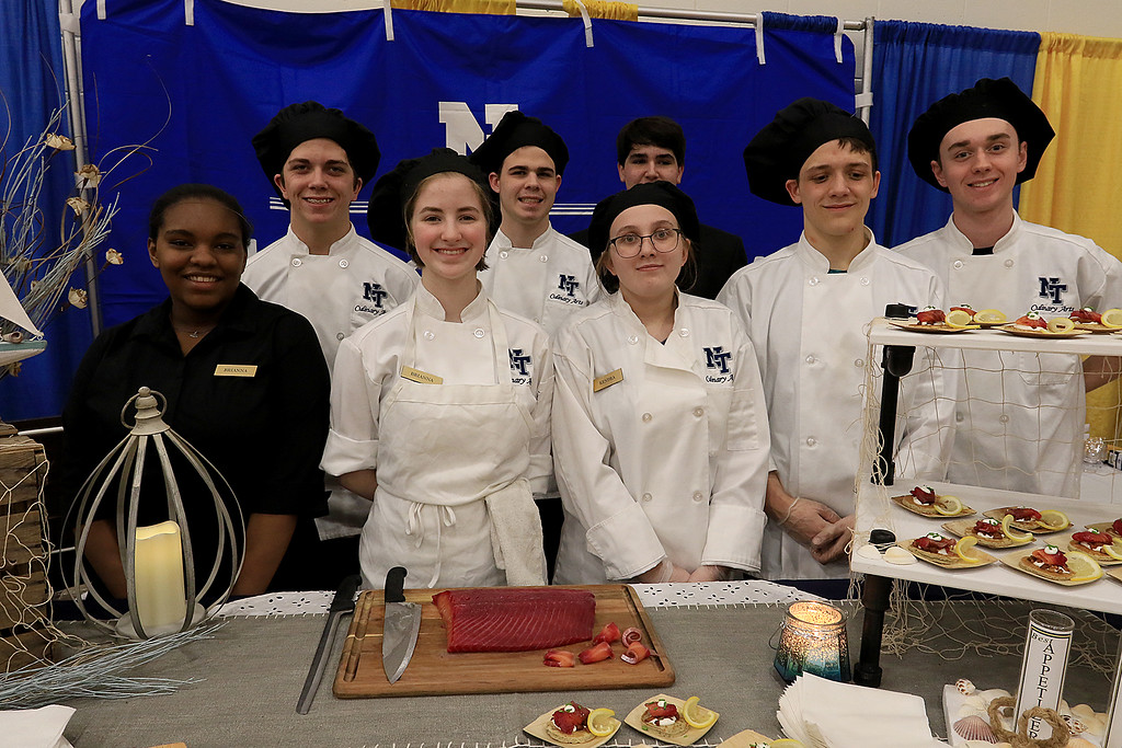 . The 18th Annual Taste of Nashoba, sponsored by the Nashoba Valley Chamber of Commerce, was held on Tuesday night at Lawrence Academy\'s Stone Athletic Center. The culinary students from Nashoba Valley Technical High School are from left in front, sophomore Brianna Clark, junior Brianna Schmoyer, junior Kendra Carter, Senior Jayson Ducharme and senior Jake Driscoll. In back, from left, is senior Dylan Bourassa, senior Connor Mann and sophomore Cory Prehl. SENTINEL & ENTERPRISE/JOHN LOVE