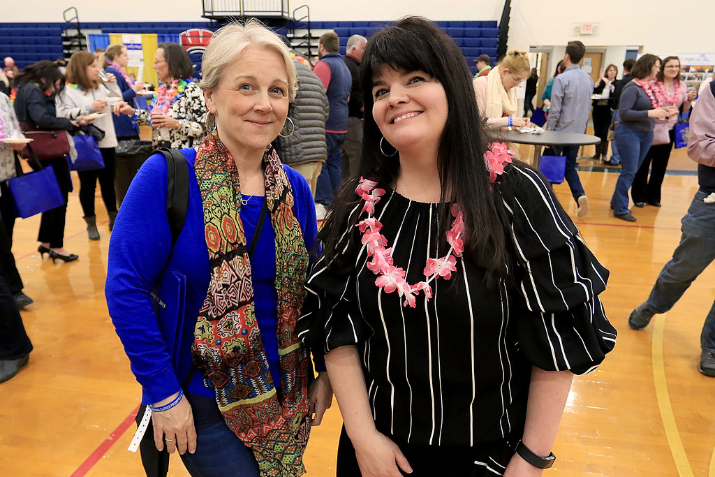 . The 18th Annual Taste of Nashoba, sponsored by the Nashoba Valley Chamber of Commerce, was held on Tuesday night at Lawrence Academy\'s Stone Athletic Center. Enjoying themselves at the event is Heather Hasz of Ayer with Nashoba Valley Chamber of Commerce President/CEO Melissa Fetterhoff. SENTINEL & ENTERPRISE/JOHN LOVE