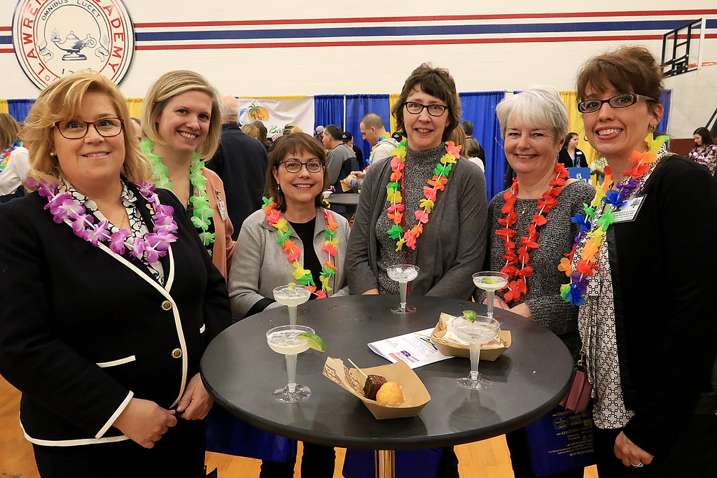 . The 18th Annual Taste of Nashoba, sponsored by the Nashoba Valley Chamber of Commerce, was held on Tuesday night at Lawrence Academy\'s Stone Athletic Center. Enjoying some of the good food and a drink at the event is, from left, Nashoba Nursing and Hospice employees Vanessa Perini, Whitney Rohrer, Terri Counihan, Sharon Veasie, Rosemary Anderson and Joanne McCole. SENTINEL & ENTERPRISE/JOHN LOVE