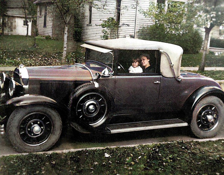 Retouched Version:  An early (both hubcaps and radiator cap) 54CC w/Artillery Wood Wheels and after market accessory search light.  Interesting also are the black-backed head and parking lights (should be chrome).  Taken in Elwood Indiana, Circa 1931-32.
