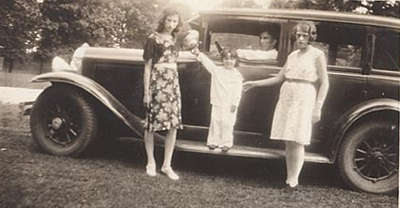 3 Woman and 29 Buick Sedan (with missing hubcap)