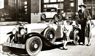 "29-44 Roadster:  Jacob Rheuben Erich (aka: "" Pecos Bil""; aka:  Jack Earle) the biggest man in Texas seen beside the then latest 1929 Buick, standing outside a local El Paso, TX Buick dealership.  The roadster has the optional Mercury Boy Radiator cap.  Note:  2 cars in right hand window both appear to be 1929 Buick Close-Coupled Sedans with Artillery Wood Wheels.  Circa late 1928."