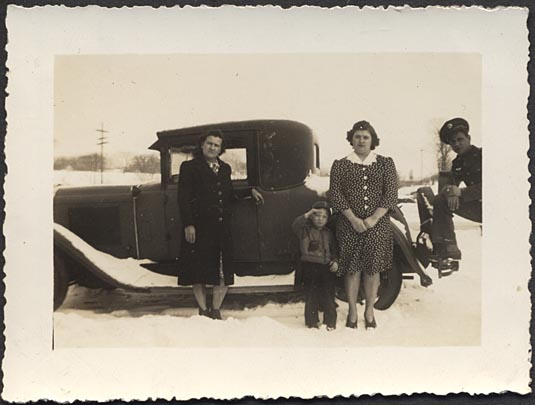 Family & policeman with coupe