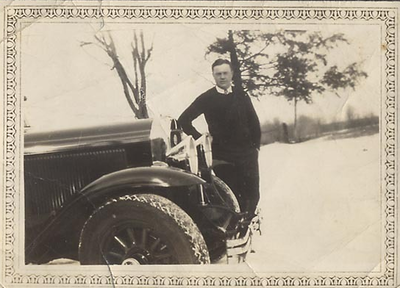 Elegant man and 29 Buick in Snow