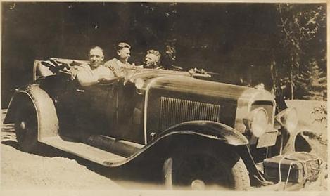 Three men in a 29-44 roadster