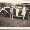 3 ladies standing beside a 29 Sedan (note missing hubcap on rear wheel)